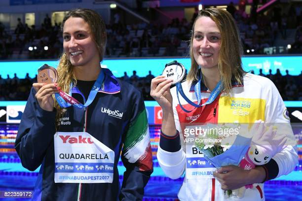 Italy's Simona Quadarella and Spain's Mireia Belmonte celebrate on the podium after the women's 1500m freestyle final during the swimming competition...