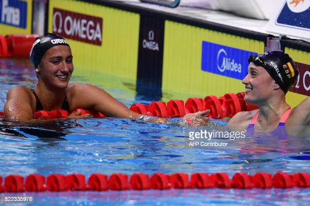 Italy's Simona Quadarella and Spain's Mireia Belmonte react after competing in the women's 1500m freestyle final during the swimming competition at...