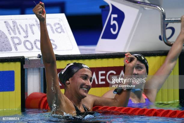 Italy's Simona Quadarella and Spain's Mireia Belmonte reacts after competing in the women's 1500m freestyle final during the swimming competition at...