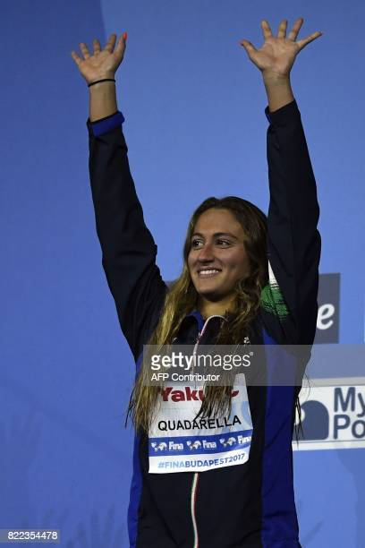 Italy's Simona Quadarella celebrates on the podium after the women's 1500m freestyle final during the swimming competition at the 2017 FINA World...
