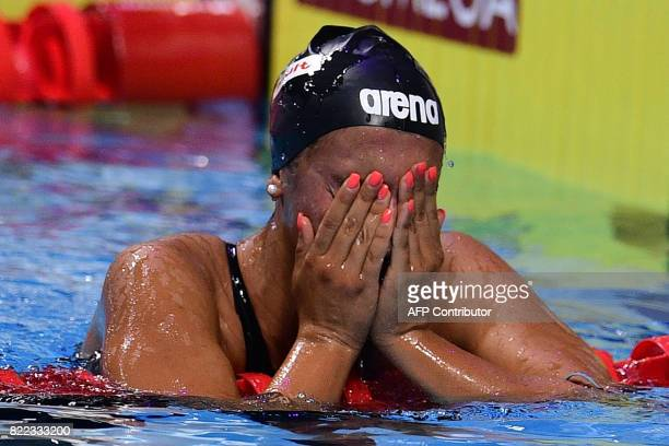 Italy's Simona Quadarella reacts after competing in the women's 1500m freestyle final during the swimming competition at the 2017 FINA World...
