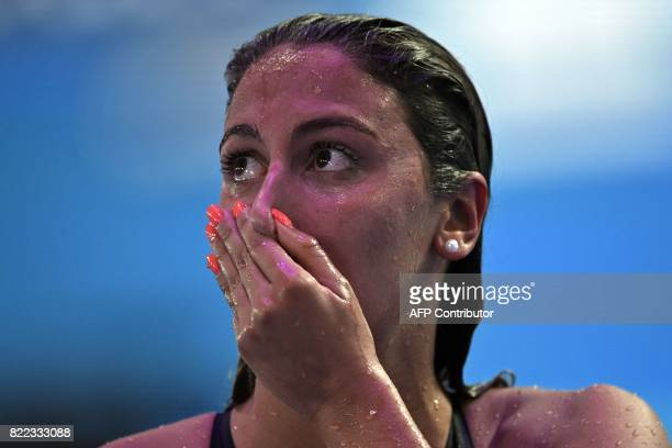 Italy's Simona Quadarella Spain's Mireia Belmonte reacts after competing in the women's 1500m freestyle final during the swimming competition at the...