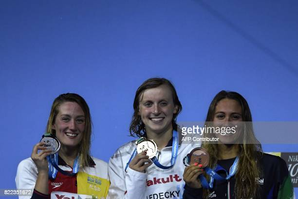 Italy's Simona Quadarella US Katie Ledecky and Spain's Mireia Belmonte celebrate on the podium after the women's 1500m freestyle final during the...