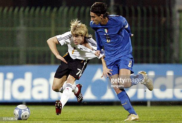 Italy's Simone Bentivoglio tries to stop Germany's Timo Kunert during the Men's U20 international friendly match between Italy and Germany at the...