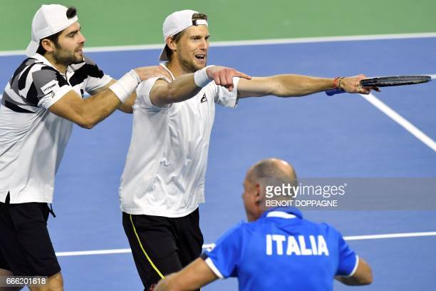 Italy's Simone Bolelli and Andreas Seppi celebrate after winning the third game of the Davis Cup World Group quarterfinal between Belgium and Italy...