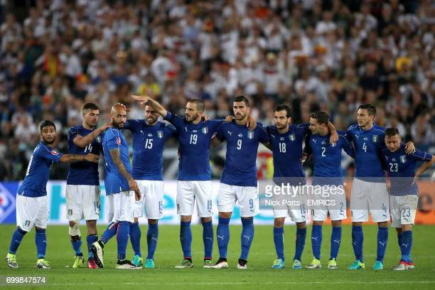 Italy's Simone Zaza is consoled by teammates after missing his penalty in the shootout