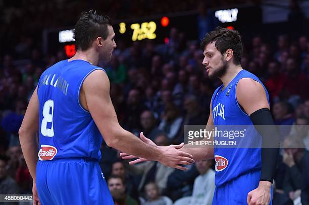 Italy's small forward Danilo Gallinari and Italy's small forward Alessandro Gentile greet while substituting during the round of 16 basketball match...