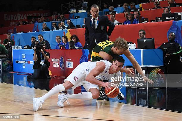 Italy's small forward Danilo Gallinari and Lithuania's forward Mindaugas Kuzminskas fall during the round of 8 basketball match between Italy and...