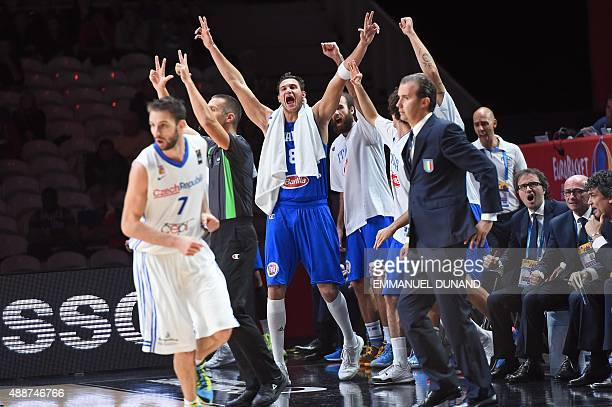 Italy's small forward Danilo Gallinari reacts with teammates and Italy's head coach Simone Pianigiani during the classification basketball match...
