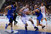 Italy's small forward Luigi Datome and Italy's centre Marco Cusin defend against Croatia's shooting guard Mario Hezonja during the final match of the...