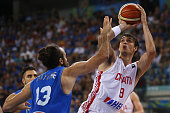 Italy's small forward Luigi Datome defends against to Croatia's forward Dario Saric during the final match of the Olympic Qualifying Tournament...