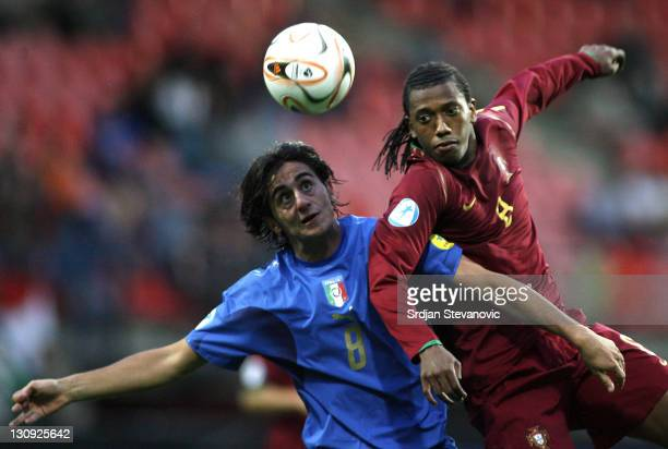 Italy's soccer player Alberto Aquilani left battle for the ball with Portugal's Manuel Fernandes right during their Olympic 2008 qualifying soccer...