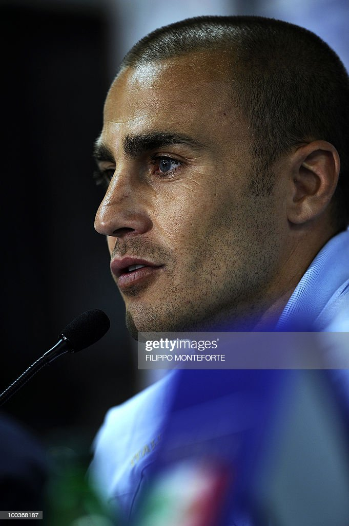 Italy's soccer team captain Fabio Cannavaro smiles during a press conference in Sestriere on May 24, 2010. The italian team started are retreating in the mountains of Sestriere before the FIFA World Cup 2010 in South Africa. AFP PHOTO / Filippo MONTEFORTE