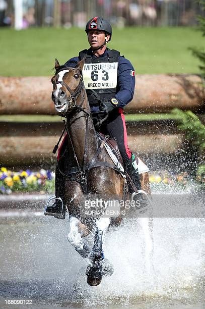Italy's Stefano Brecciaroli riding Apollo VD Wendi Kurt Hoeve jumps the water during the cross country test of the Badminton Horse Trials in...