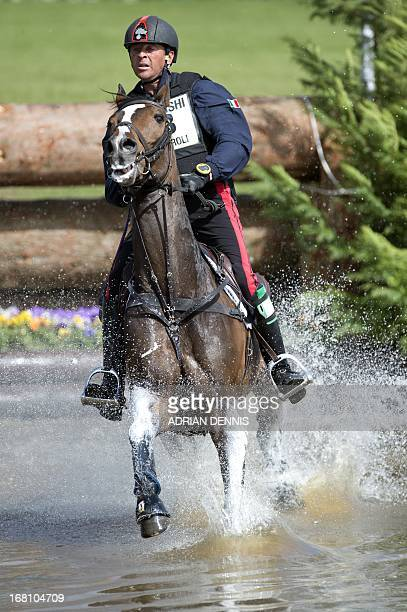 Italy's Stefano Brecciaroli riding Apollo VD Wendi Kurt Hoeve jumps the 9th fence the water jump during the crosscountry test of the Badminton Horse...