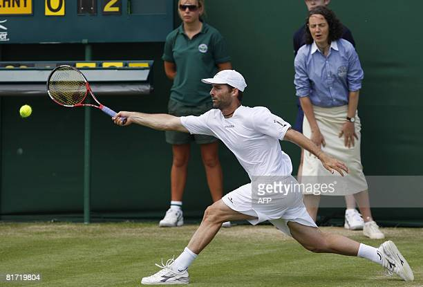 Italy's Stefano Galvani returns the ball to his Russian opponent Mikhail Youzhny during their 2008 Wimbledon championships tennis match at The All...