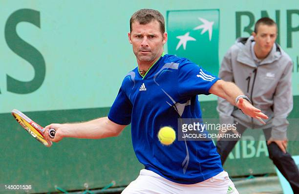 Italy's Stefano Galvani returns to France's Augustin Gensse on May 22 2012 at the Roland Garros stadium in Paris during the first round qualification...