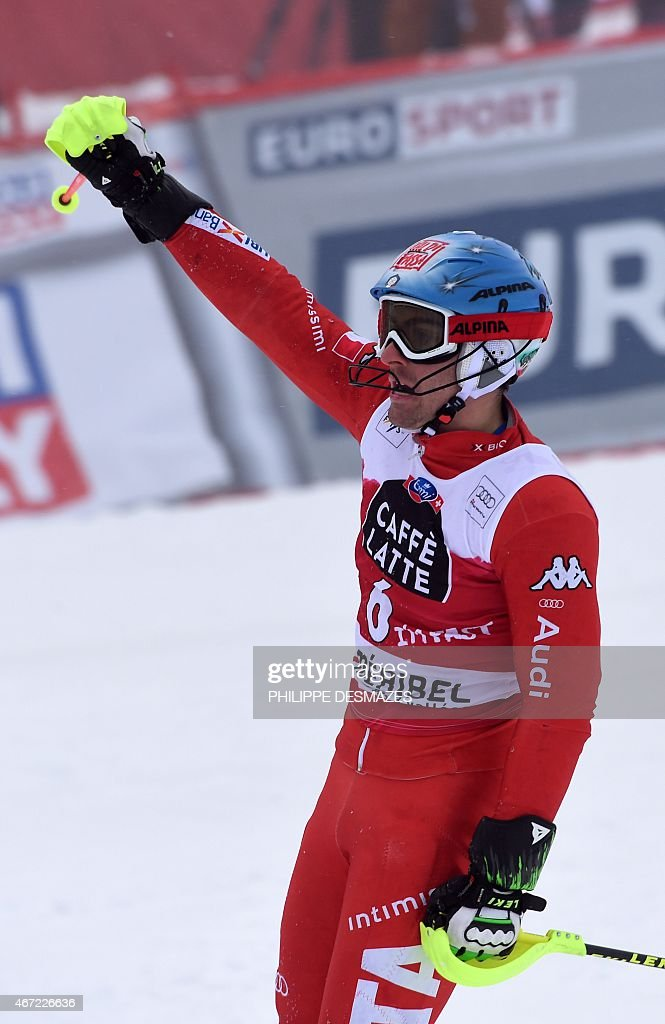 Italy's <a gi-track='captionPersonalityLinkClicked' href=/galleries/search?phrase=Stefano+Gross&family=editorial&specificpeople=5678979 ng-click='$event.stopPropagation()'>Stefano Gross</a> reacts after taking part in the first run of the Men's Slalom race at the FIS Alpine Skiing World Cup finals in Meribel on March 22, 2015.