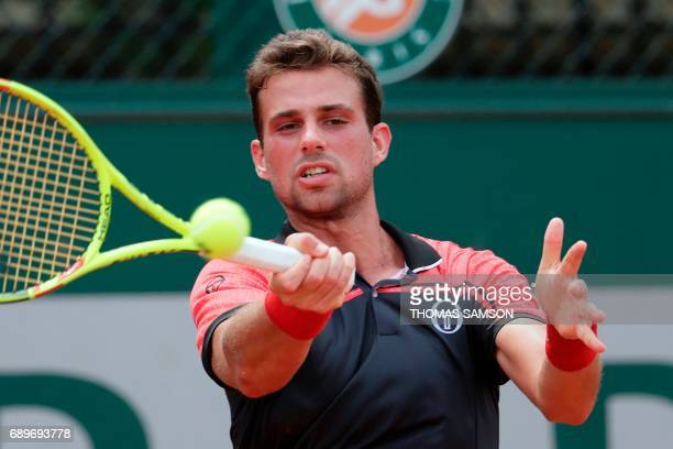 Italy's Stefano Napolitano returns the ball to Germany's Alexander Zverev during their tennis match at the Roland Garros 2017 French Open on May 29...