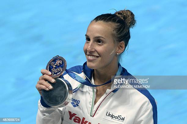 Italy's Tania Cagnotto celebrates with her bronze medal during the podium ceremony for the Women's 3m Springboard final diving event at the 2015 FINA...