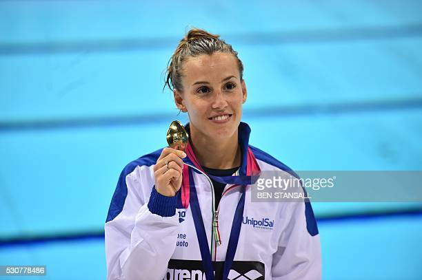 Italy's Tania Cagnotto poses with her gold medal after winning the final of the 1m women's Springboard diving event on Day 3 of the European aquatics...