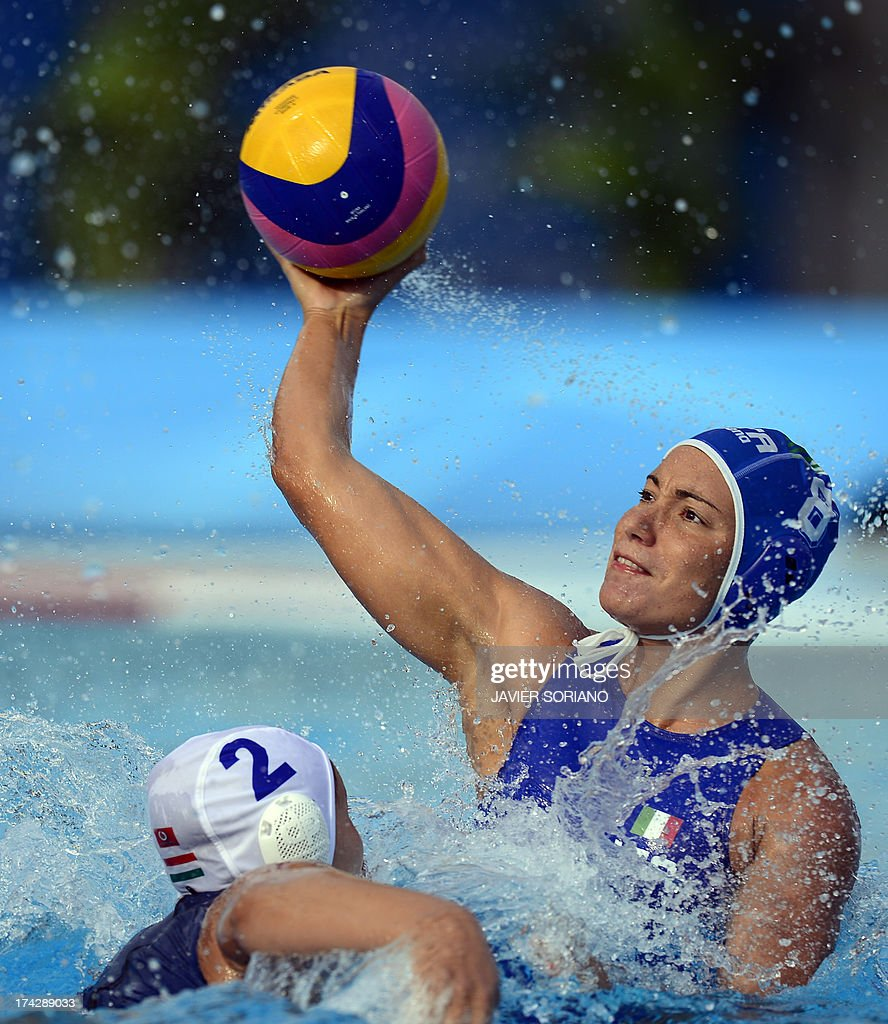 Italy's Tania di Mario (R) vies with Hungary's Anna Krisztina Illes (L) during their preliminary round match Hungary vs Italy of the women's water polo competition at the FINA World Championships in Bernat Picornell pools in Barcelona on July 23, 2013. AFP PHOTO / JAVIER SORIANO
