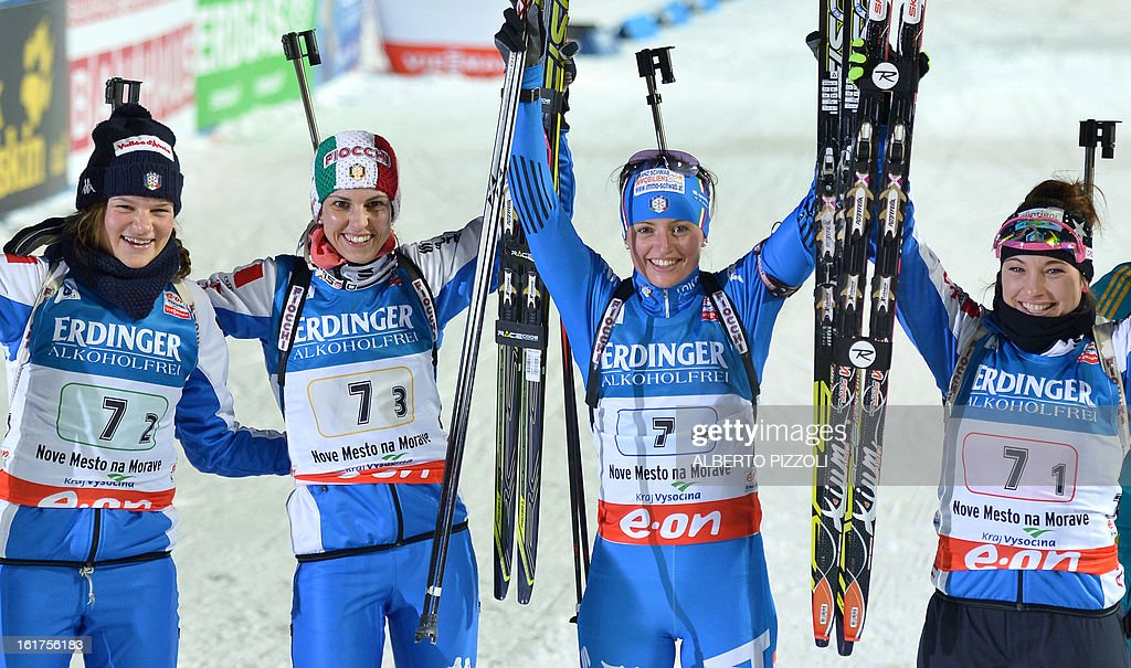 Italy's team (L to R) Nicole Gontier, Michela Ponza, Karin Oberhofer and Dorothea Wierer celebrate after the Women 4x6km relay event of the IBU Biathlon World Championships in Nove Mesto, Czech Republic, on February 15, 2013. Norway's won the event ahead of Ukraine (2nd) and Italy (3rd). AFP PHOTO/MICHAL CIZEK