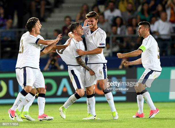 Italy's team reacts after Federico Bernardeschi scored a goal during the UEFA U21 European Championship football semi final match Spain v Italy in...