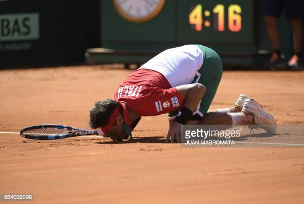 Italy's tennis player Fabio Fognini celebrates after defeating 26 46 63 64 62 Argentina's Guido Pella during their 2017 Davis Cup World Group first...