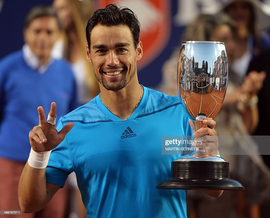 Italy's tennis player Fabio Fognini holds his trophy after winning over Leonardo Mayer from Argentina in the ATP Vina del Mar tournament final...