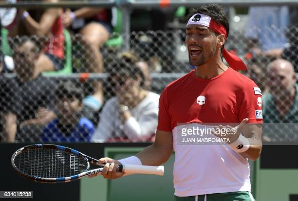 Italy's tennis player Fabio Fognini reacts after missing a point during the 2017 Davis Cup World Group first round single tennis match against...