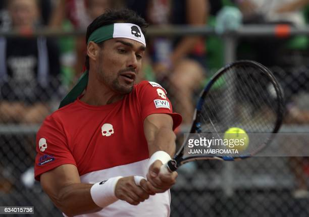 Italy's tennis player Fabio Fognini returns the ball to Argentina's Guido Pella during the 2017 Davis Cup World Group first round single tennis match...