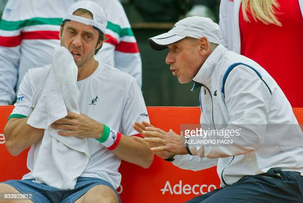 Italy's tennis player Paolo Lorenzi receives instructions from his team captain Corrado Barazzutti during the 2017 Davis Cup World Group first round...