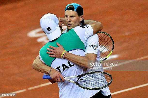 Italys tennis players Simone Bolelli hugs Andreas Seppi as they celebrate after winning against Swiss team composed by Marco Chiudinelli and Henri...