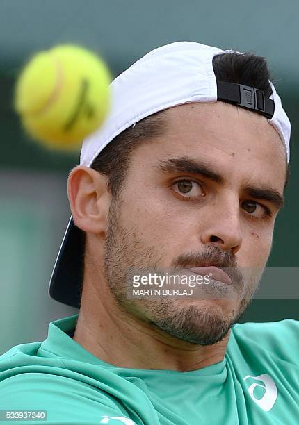 Italy's Thomas Fabbiano returns the ball to Spain's Feliciano Lopez during their men's first round match at the Roland Garros 2016 French Tennis Open...