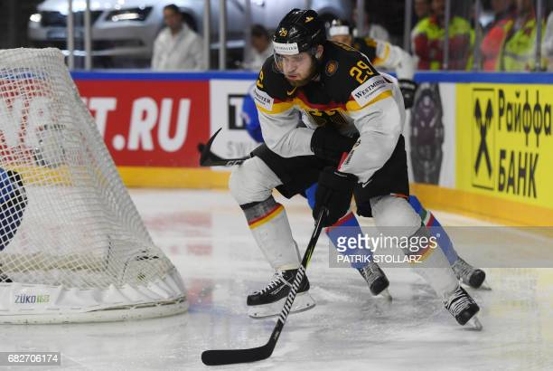 Italy´s Thomas Larkin and Germany´s Leon Draisaitl vie during the IIHF Ice Hockey World Championships first round match between Italy and Germany in...