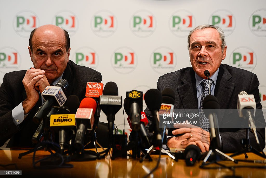 Italy's top anti-Mafia prosecutor, Piero Grasso, and Democratic Party leader Pier Luigi Bersani (L) give a press conference at the Democratic Party (PD) headquarters on December 28, 2012 in Rome to present Grasso's candidacy at the upcoming general elections in Italy. Italy closes 2012 on an upbeat note, with renewed confidence on the markets and optimism among analysts that the worst of the financial crisis is over, despite political uncertainty expected in the run-up to the February general election. AFP PHOTO / ANDREAS SOLARO