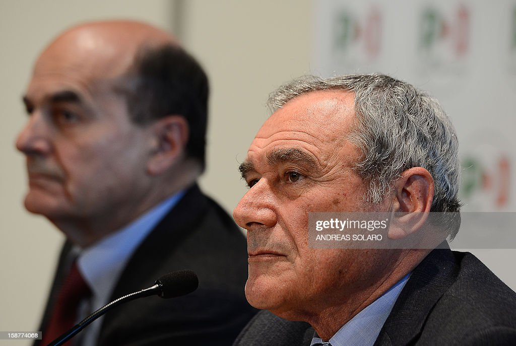 Italy's top anti-Mafia prosecutor, Piero Grasso, and Democratic Party leader Pier Luigi Bersani (L) give a press conference at the Democratic Party (PD) headquarters on December 28, 2012 in Rome to present Grasso's candidacy at the upcoming general elections in Italy. Italy closes 2012 on an upbeat note, with renewed confidence on the markets and optimism among analysts that the worst of the financial crisis is over, despite political uncertainty expected in the run-up to the February general election.