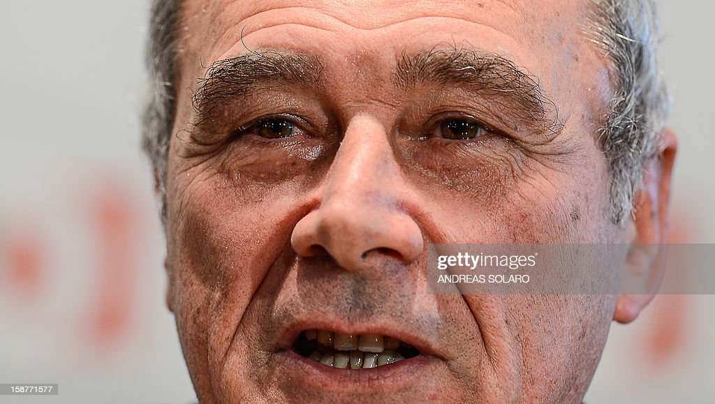 Italy's top anti-Mafia prosecutor, Piero Grasso, has tears in his eyes during a press conference at the Democratic Party (PD) headquarters on December 28, 2012 in Rome to present his candidacy at the upcoming general elections in Italy. Italy closes 2012 on an upbeat note, with renewed confidence on the markets and optimism among analysts that the worst of the financial crisis is over, despite political uncertainty expected in the run-up to the February general election.