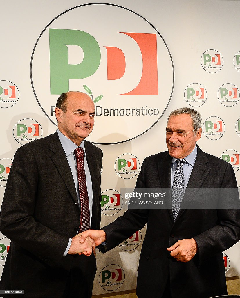 Italy's top anti-Mafia prosecutor, Piero Grasso, shakes hands with Democratic Party leader Pier Luigi Bersani (L) at the Democratic Party (PD) headquarters on December 28, 2012 in Rome before a press conference to present his candidacy at the upcoming general elections in Italy. Italy closes 2012 on an upbeat note, with renewed confidence on the markets and optimism among analysts that the worst of the financial crisis is over, despite political uncertainty expected in the run-up to the February general election. AFP PHOTO / ANDREAS SOLARO