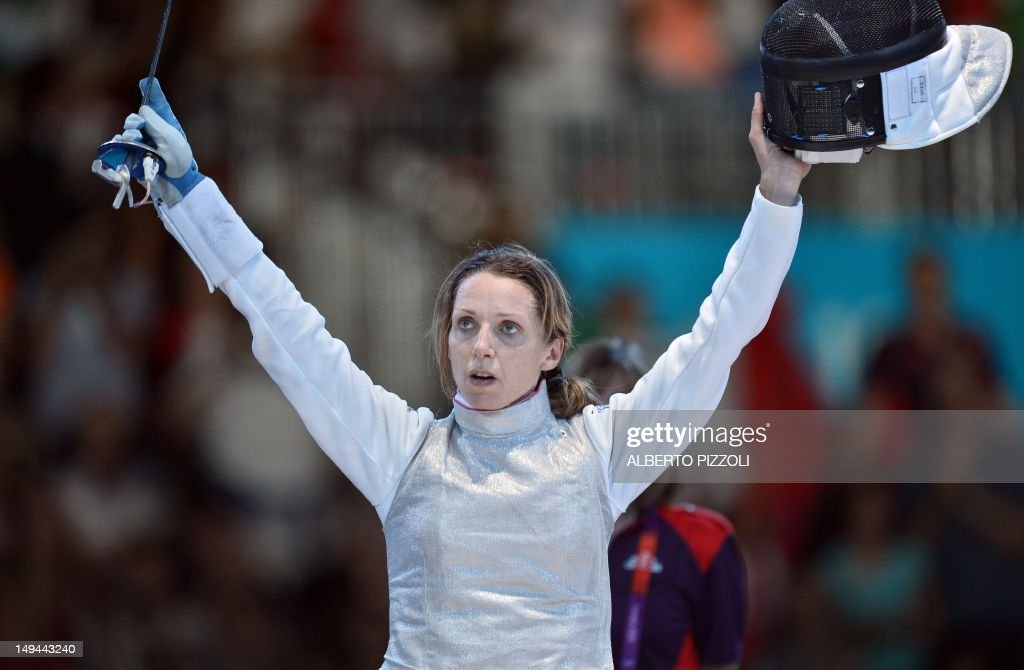 Italy's <a gi-track='captionPersonalityLinkClicked' href=/galleries/search?phrase=Valentina+Vezzali&family=editorial&specificpeople=772094 ng-click='$event.stopPropagation()'>Valentina Vezzali</a> celebrates her victory over South Korea's Nam Hyun Hee at the end of their women's foil bronze medal fencing bout as part of the London 2012 Olympic games, on July 28, 2012 at the ExCel centre in London.