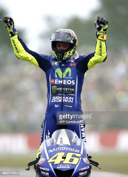 Italy's Valentino Rossi celebrates after winning the Assen Motorcycling Grand Prix at the TT circuit in Assen on June 25 2017 / AFP PHOTO / ANP /...