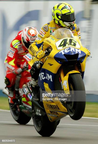 Italy's Valentino Rossi celebrates as he crosses the finishing line in second place during the British Moto GP at Donnington Park