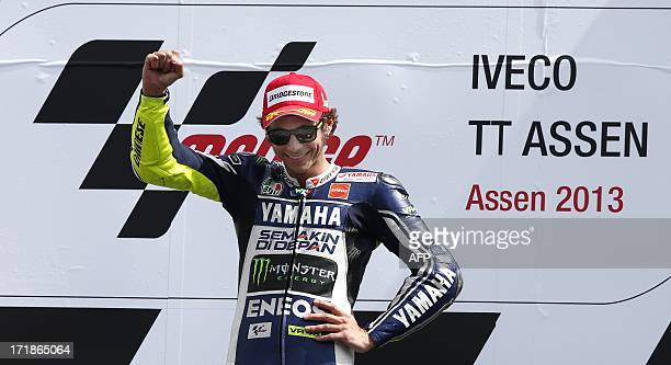 Italy's Valentino Rossi celebrates on the podium after winning the Dutch MotoGP in Assen on June 29 2013 The 34yearold who had not won since the...