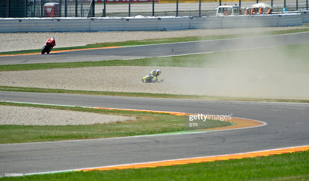 Italy's Valentino Rossi crashes his bike during the free qualifying practice of the Italian GP motorcycling race at Mugello circuit on June 5, 2010. Valentino Rossi of Yamaha fractured his right shin bone in a crash in practice on Saturday morning, ruling him out of tomorrow's Italian MotoGP. The 31-year-old nine-time world champion - seven of them at this level, comprising six at MotoGp and one at 500cc - had been fastest in practice despite still suffering the effects of a shoulder injury.