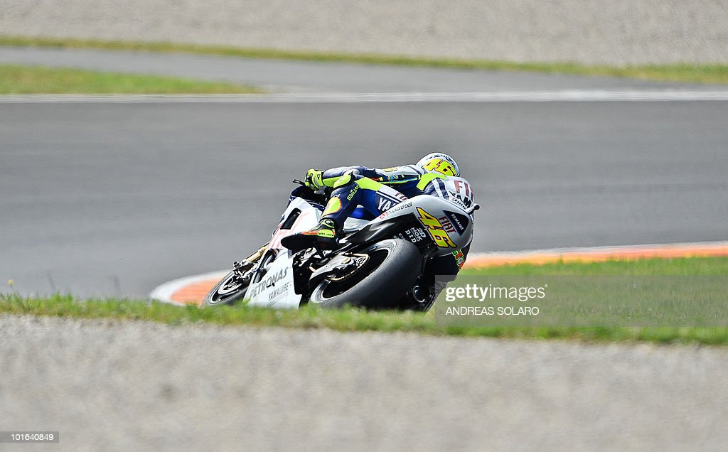 Italy's Valentino Rossi of Yamaha rides during the MotoGP free practice of the Italian Grand Prix at Mugello track on June 05, 2010. Valentino Rossi of Yamaha fractured his right shin bone in a crash during the free practice, ruling him out of tomorrow's Italian MotoGP. The 31-year-old nine-time world champion - seven of them at this level, comprising six at MotoGp and one at 500cc - had been fastest in practice despite still suffering the effects of a shoulder injury.