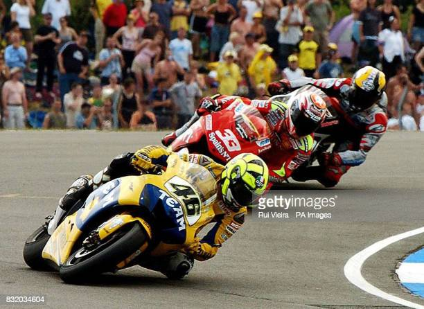 Italy's Valentino Rossi on his way to second place with Italy's Marco Melandri in third place during the British Moto GP at Donnington Park