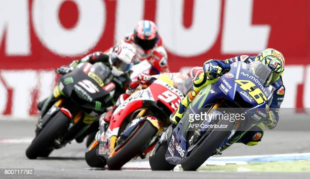 Italy's Valentino Rossi wins the Assen Motorcycling Grand Prix at the TT circuit in Assen on June 25 2017 / AFP PHOTO / ANP / Vincent Jannink /...