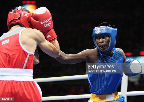 Italy's Vicenzo Picardi fights against Zambia's Cassius Chiyanika during their 2008 Olympic Games Flyweight boxing bout on August 12 2008 in Beijing...
