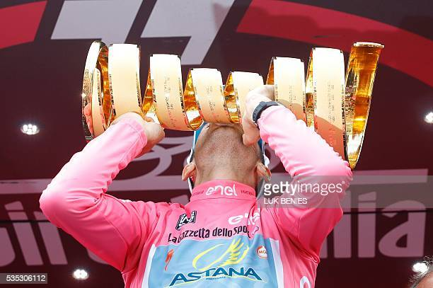 Italy's Vincenzo Nibali celebrates kisses the trophy on the podium after winning the 99th Giro d'Italia Tour of Italy after the 21th stage from Cuneo...